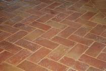 Old world terracotta tile in a backet weave pattern